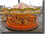 Hop aboard the galloping horses for all the fun of the fair on this all time classic. Perfect for any event, city centre or Christmas market etc. 40ft diameter, 36-seat capacity.
