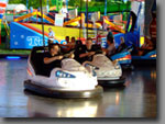 Whether you call them the Dodgems or Bumper Cars, they're fun for all ages!  Popular for all events, including music festivals, private parties etc. Various track sizes available.