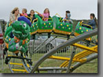 A kid-sized coaster that mums and dads can ride together with the little ones. 40ft diameter, 12-person capacity.