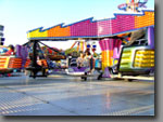 Twister A family thrill ride that offers a whirlwind of a ride every time! 50ft diameter, 24 to 36-seat capacity.