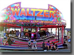 Waltzer A fairground classic that leaves all passengers in a spin! 50ft diameter, 40 to 50-seat capacity.